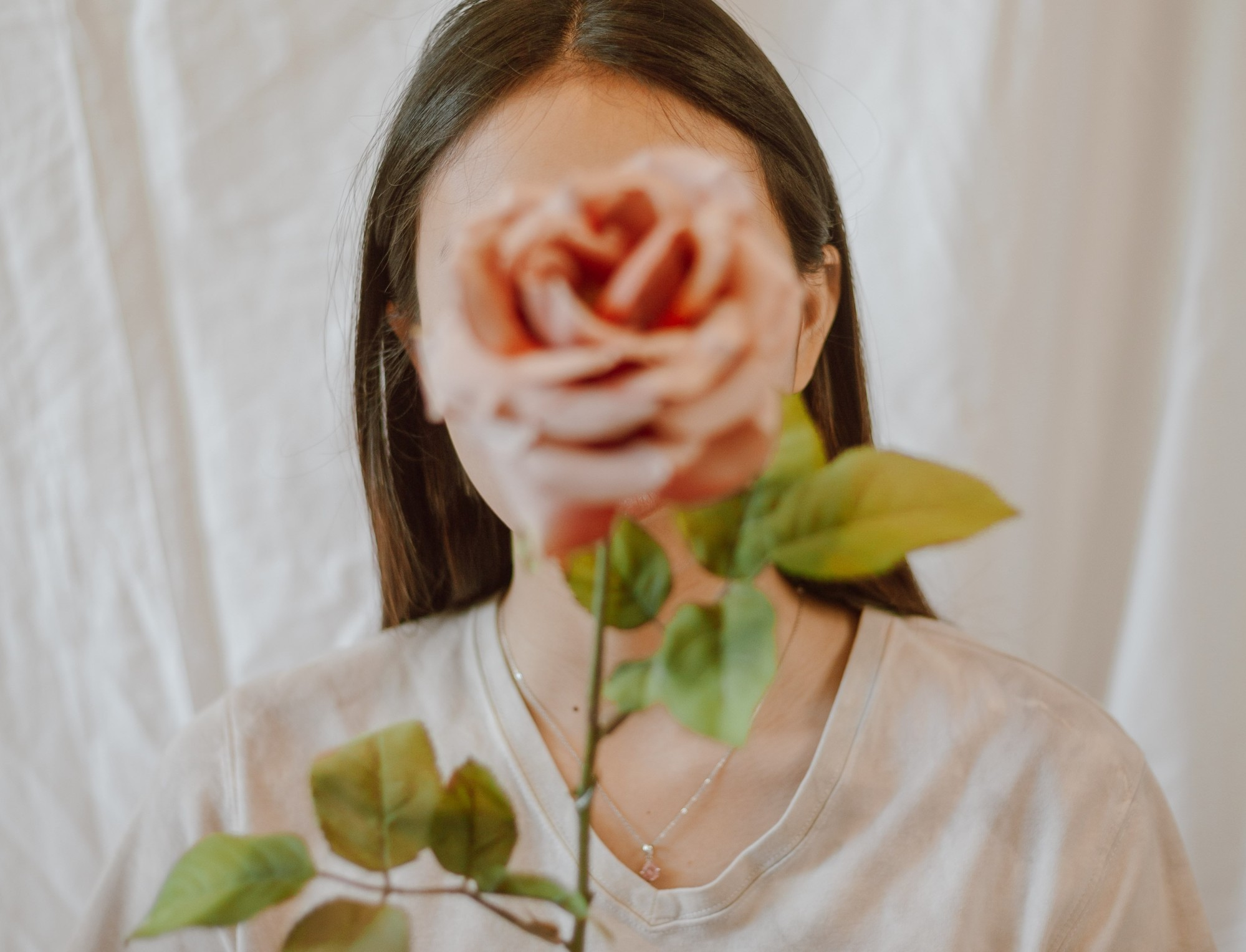 Seen, this phot of a woman with a rose in front of her face. Seen is a poem