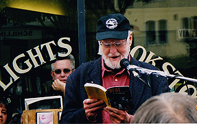 Photo of Lawrence Ferlinghetti reading in front of City Lights Books
