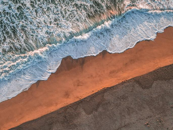 photo of an ocean shoreline to illustrate the poem entitled, Stronger